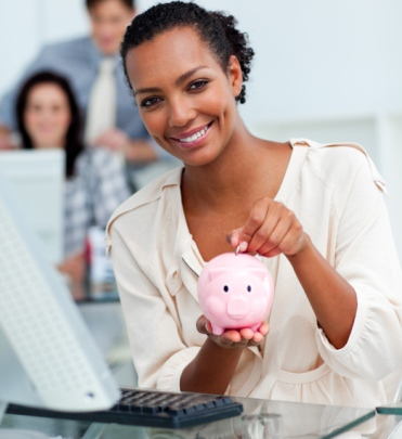 image Smiling businesswoman saving money in a piggy-bank