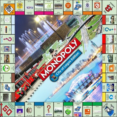 Mrs-Nimi-Akinkugbe-CEO-Bestman-Games-presenting-the-City-of-Lagos-Edition-of-Monopoly-to-Governor-Fashola 2