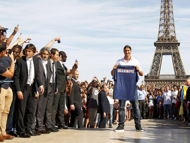 Zlatan Ibrahimovic of Sweden, newly-signed player for French soccer club Paris St Germain, holds his new jersey as he poses at Trocadero square in front of the Eiffel Tower in Paris
