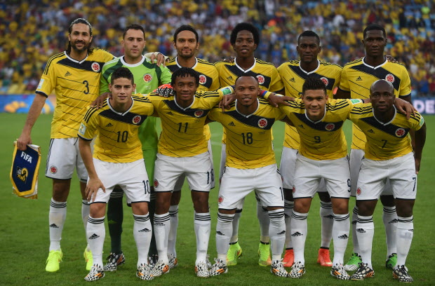 Members of Colombia's national team(Back row L-R) Colombia's defender and captain Mario Alberto Yepes, Colombia's goalkeeper David Ospina, Colombia's midfielder Abel Aguilar, Colombia's midfielder Carlos Sanchez, Colombia's forward Jackson Martinez and Colombia's defender Cristian Zapata (Front row L-R) Colombia's midfielder James Rodriguez, Colombia's midfielder Juan Guillermo Cuadrado, Colombia's defender Juan Camilo Zuniga, Colombia's forward Teofilo Gutierrez and Colombia's defender Pablo Armero  pose for the team photo prior to  the Round of 16 football match between Colombia and Uruguay at the Maracana Stadium in Rio de Janeiro during the 2014 FIFA World Cup in Brazil on June 28, 2014.   AFP PHOTO / EITAN ABRAMOVICHEITAN ABRAMOVICH/AFP/Getty Images