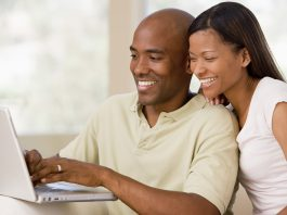 black people reading economic news