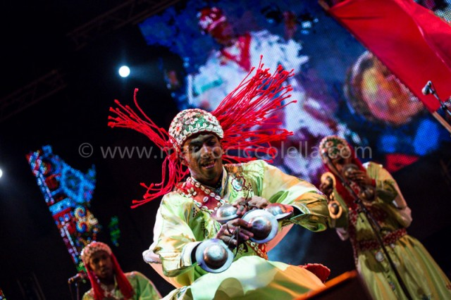 Gnaoua a musician during his performance playing the typical Krakebs