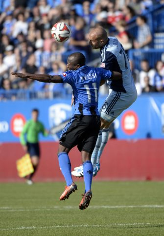 May 10, 2014; Montreal, Quebec, CAN; Head ball between Montreal Impact midfielder Sanna Nyassi (11) and Sporting KC defender Aurelien Collin (78) during the second half at Stade Saputo. Mandatory Credit: Eric Bolte-USA TODAY Sports