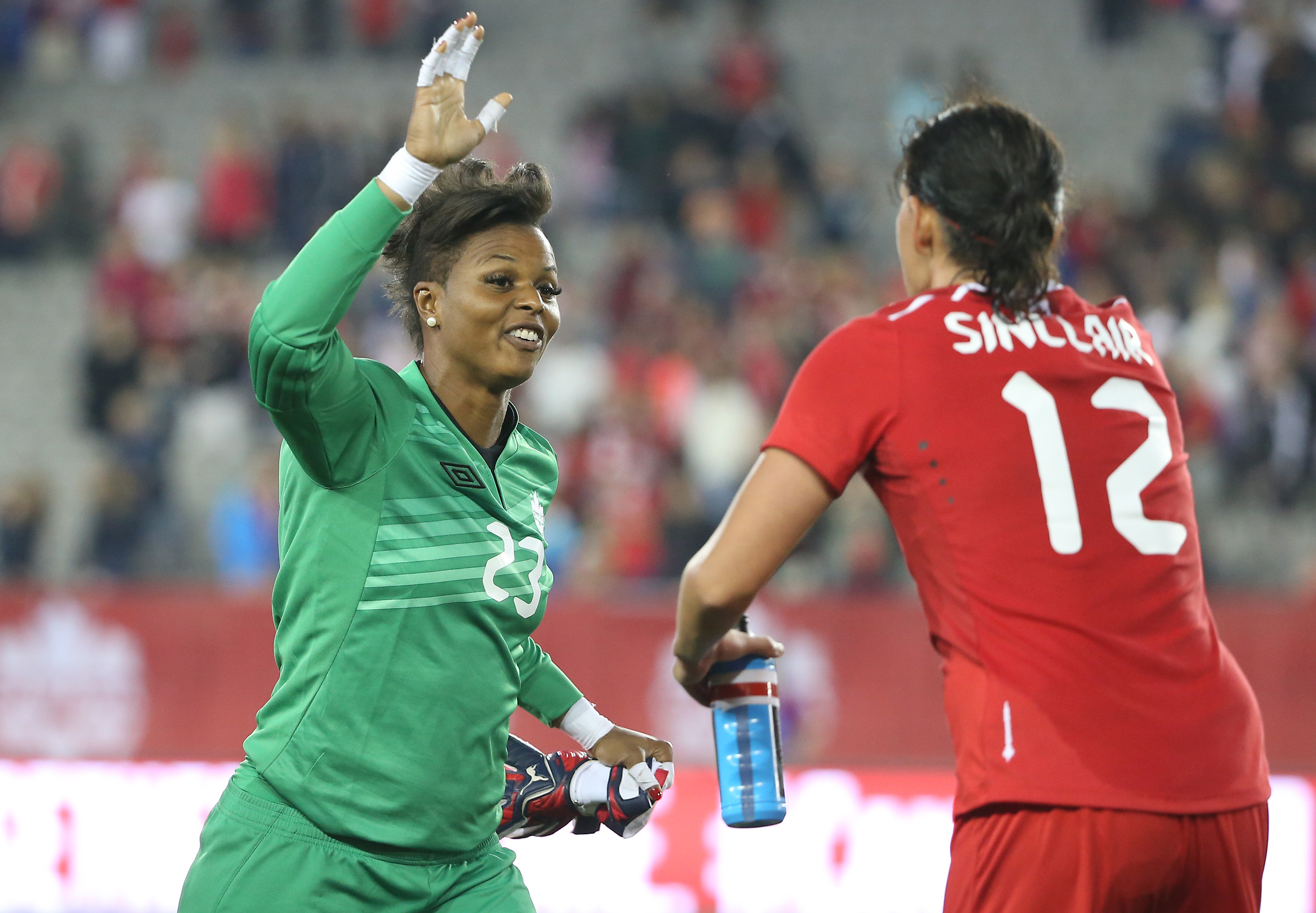 HAMILTON, CANADA - MAY 29: Karina LeBlanc #23 of Canada celebrates their victory with Christine Sinclair #12 against England during their Women's International Friendly match on May 29, 2015 at Tim Hortons Field in Hamilton, Ontario, Canada. (Photo by Tom Szczerbowski/Getty Images)
